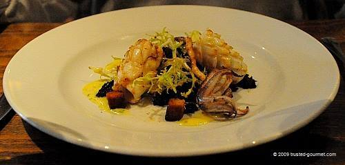 Chargrilled cornish squid, black pudding and curly endive salad