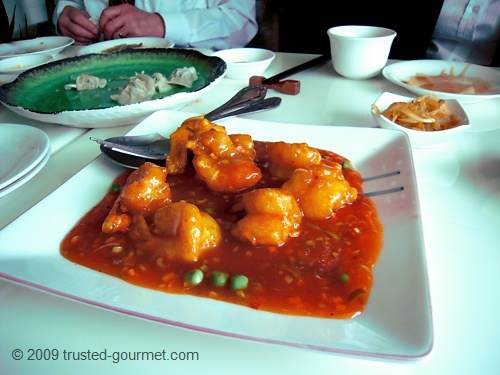 Butterfly prawns in chilli sauce &amp; kau chi dumplings