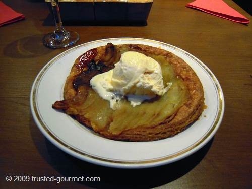 Thin apple tart cooked upside down